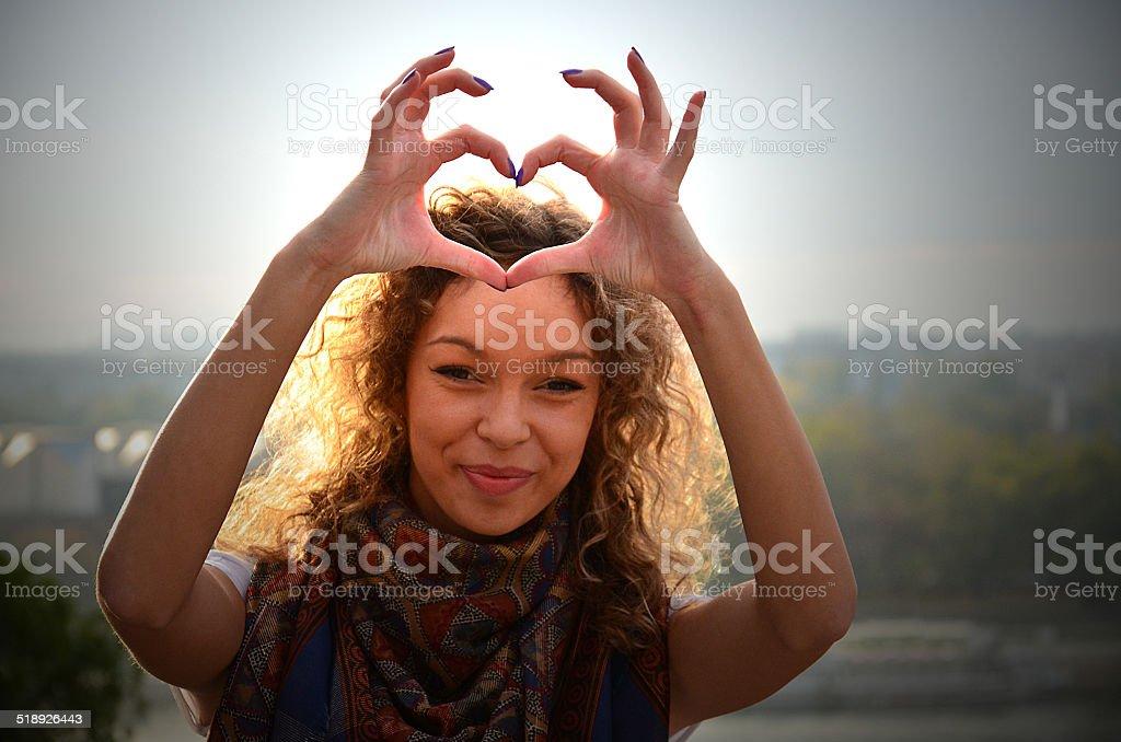 Girl making Heart Shape stock photo
