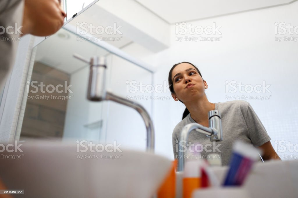Girl making mouthwash in the morning stock photo