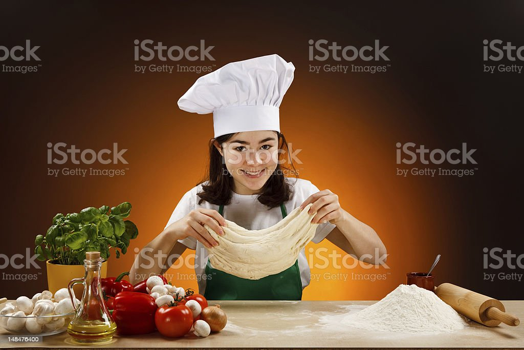 Girl making pizza dough royalty-free stock photo