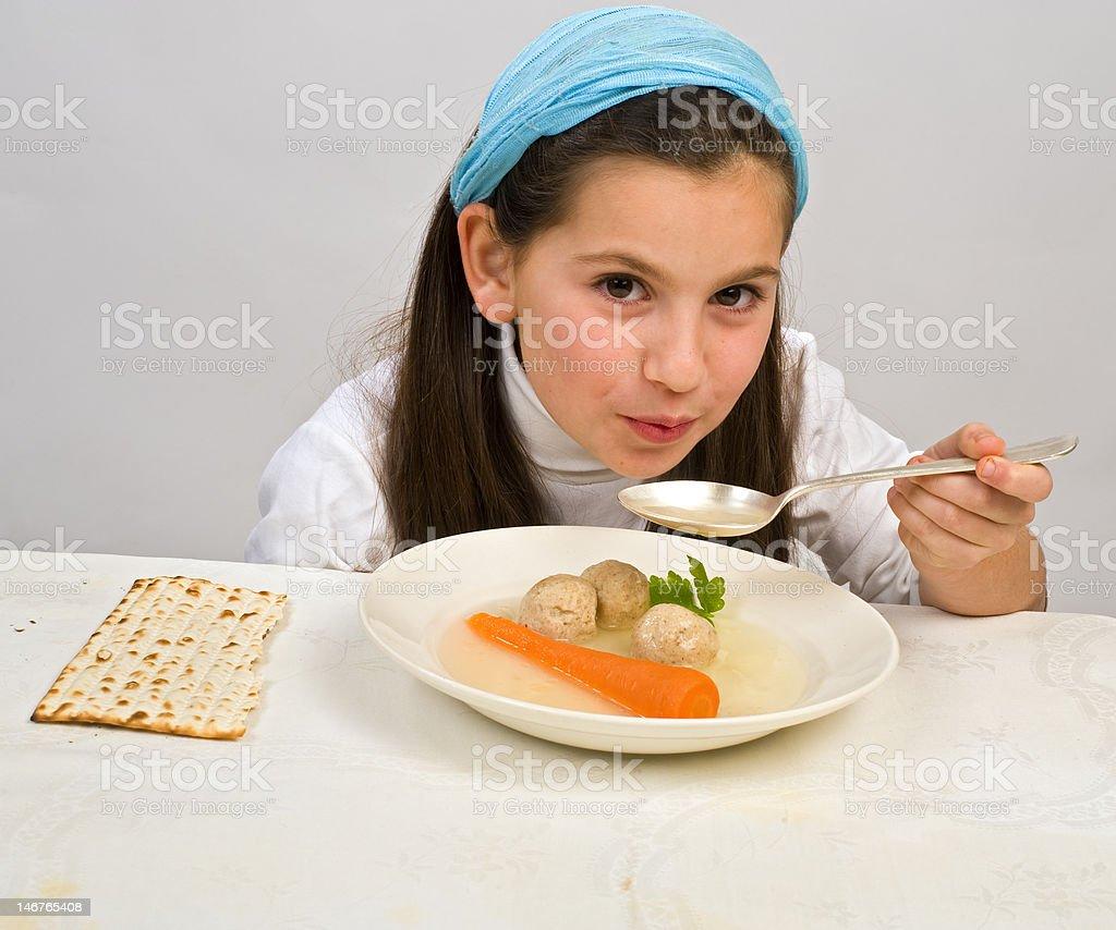 girl matzo ball soup stock photo