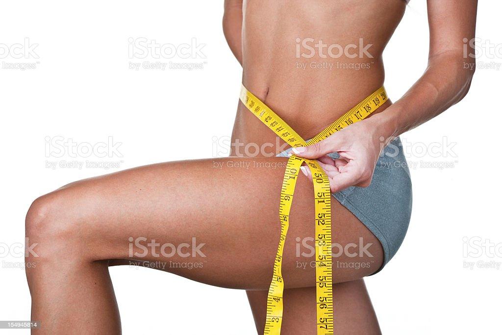 Girl measuring her waist royalty-free stock photo