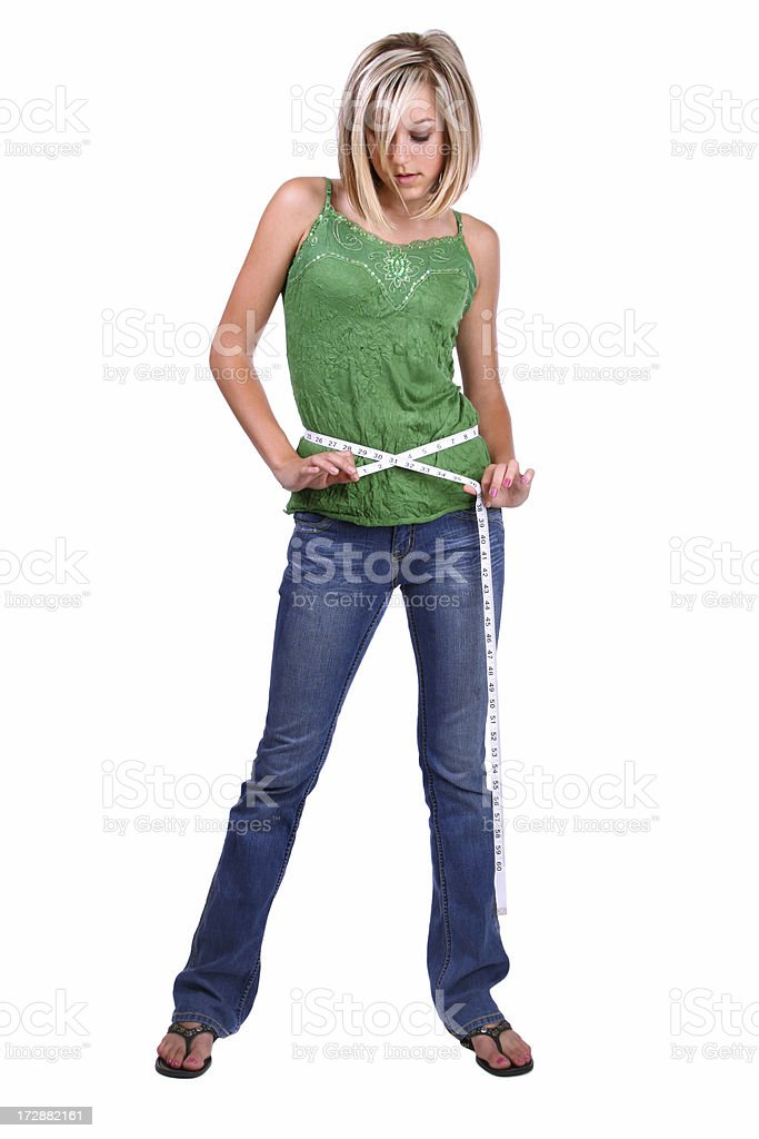 Girl Measuring Herself royalty-free stock photo
