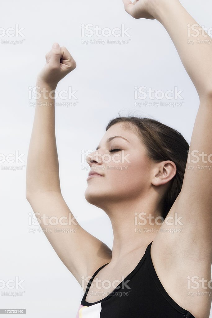 Girl meditating - arms raised stock photo