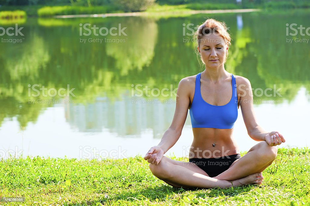 girl meditating in the lotus position royalty-free stock photo