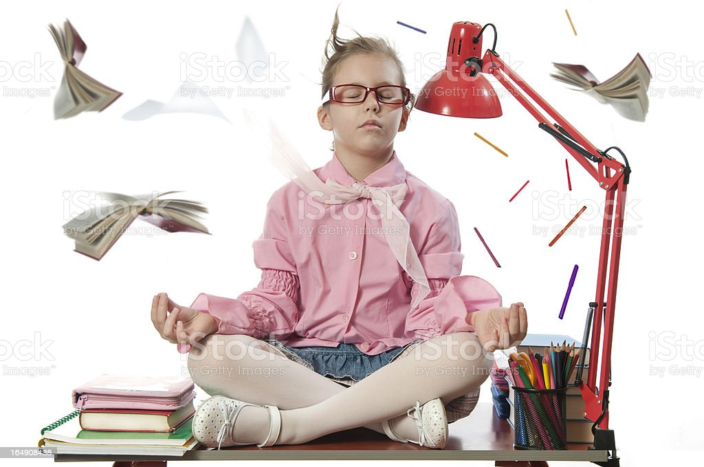 Girl meditating on the desk royalty-free stock photo