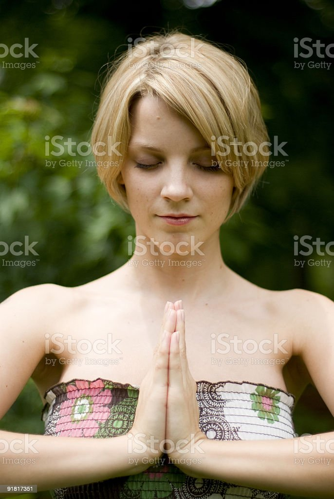 Girl meditating royalty-free stock photo