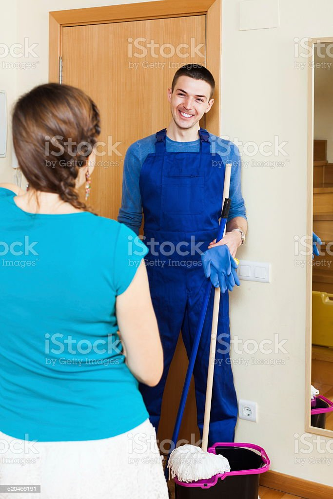 Girl meeting smiling cleaner stock photo