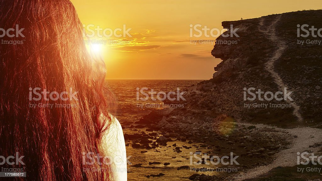 Girl meets sunset stock photo