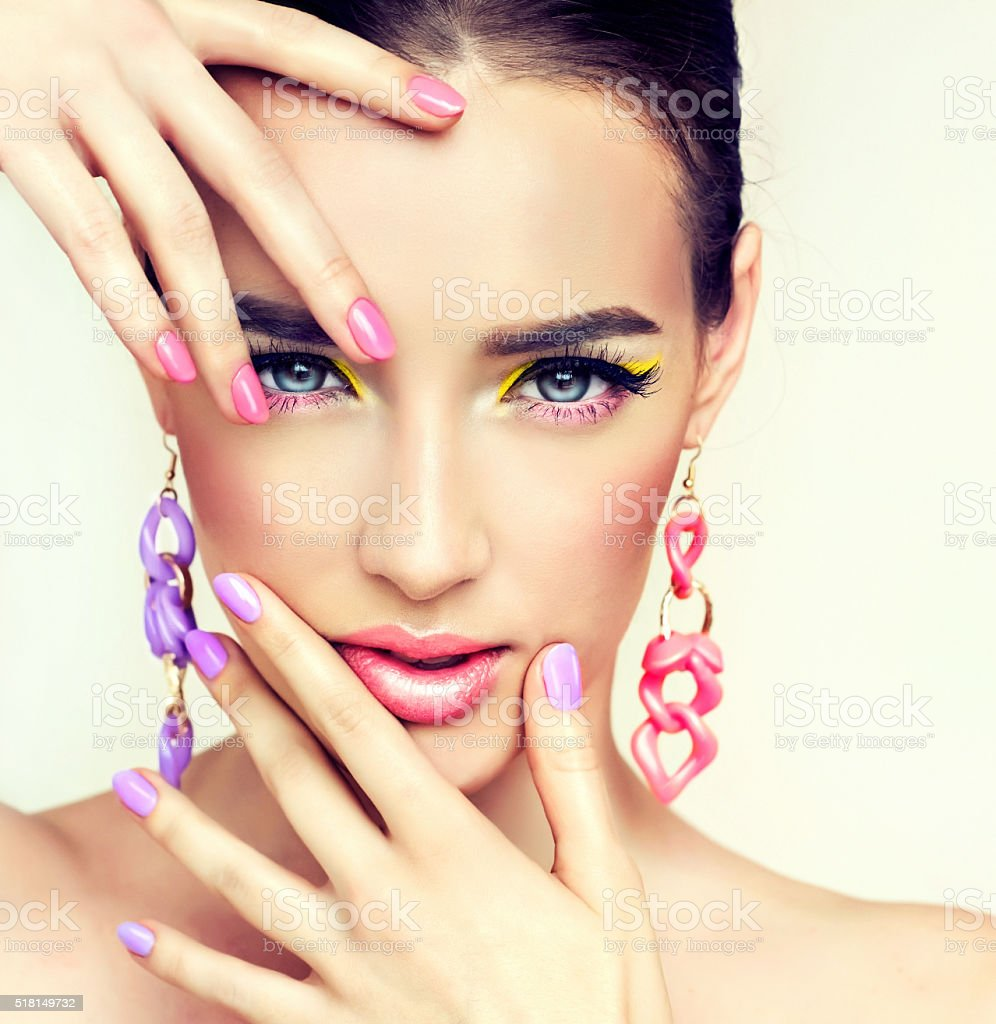 Girl model with bright make-up and coloured nail. Spring style. stock photo