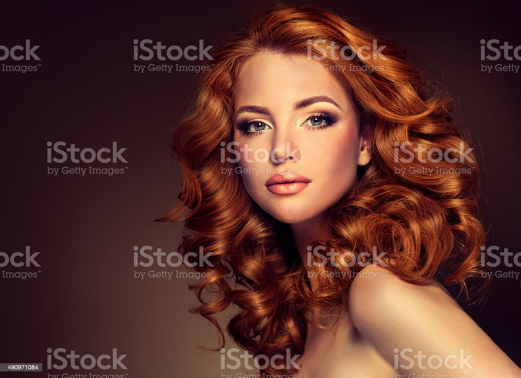 Girl model with long curly red hair. stock photo