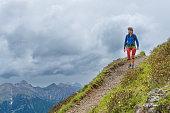 Girl mountain trail walks alone