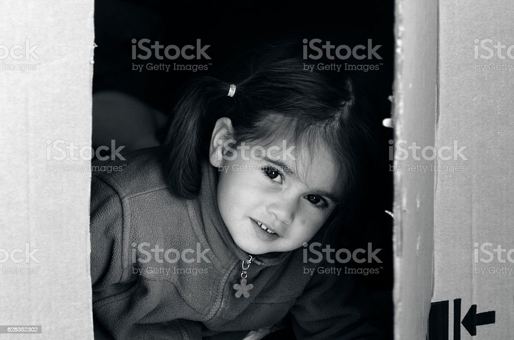 Girl moving to a new home stock photo