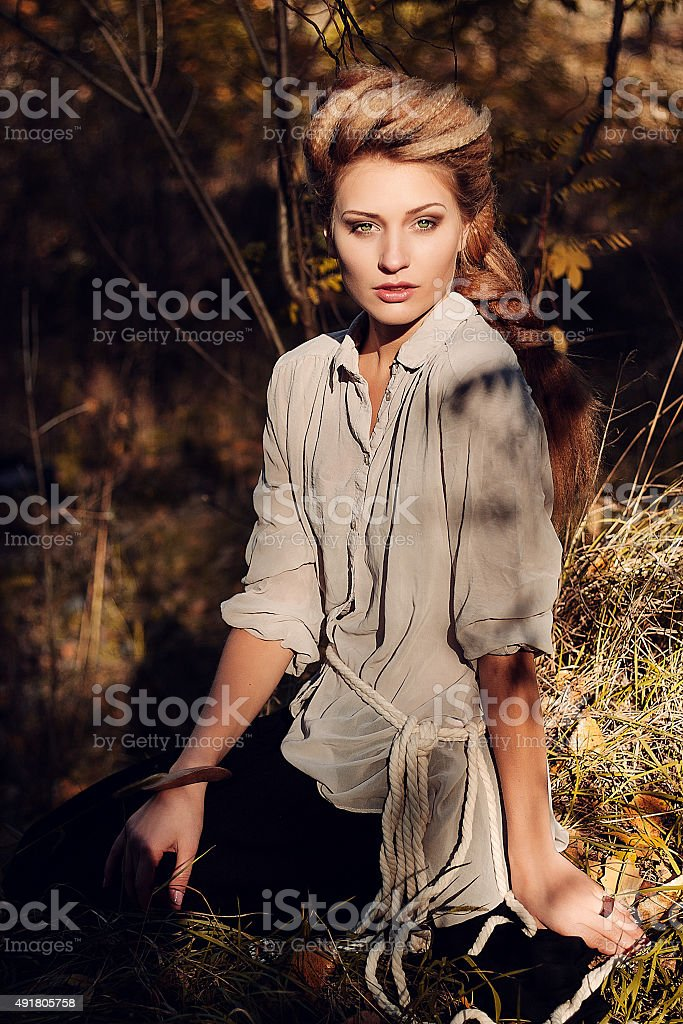 girl national clothes in the forest stock photo