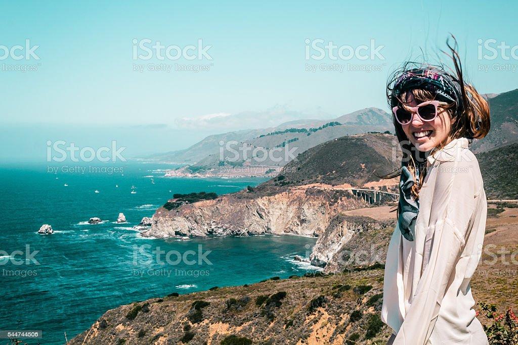 Girl near Bixby Bridge in California Coast stock photo