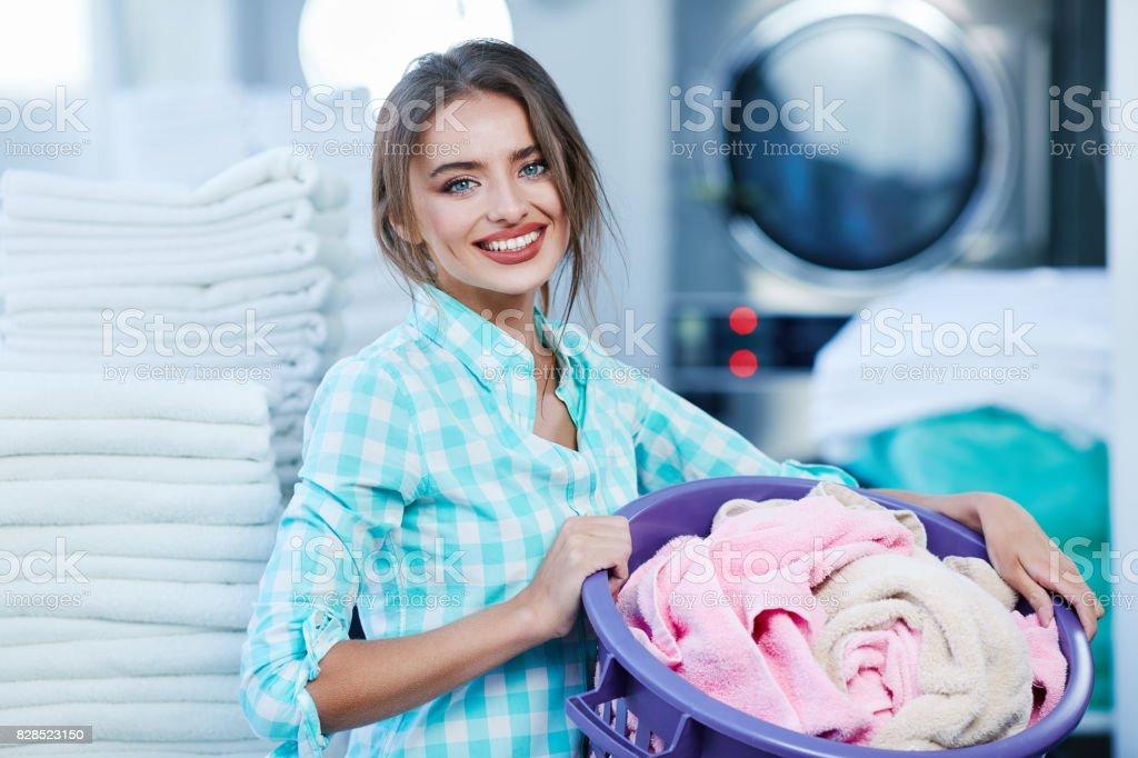 Girl near rose and white linen stock photo