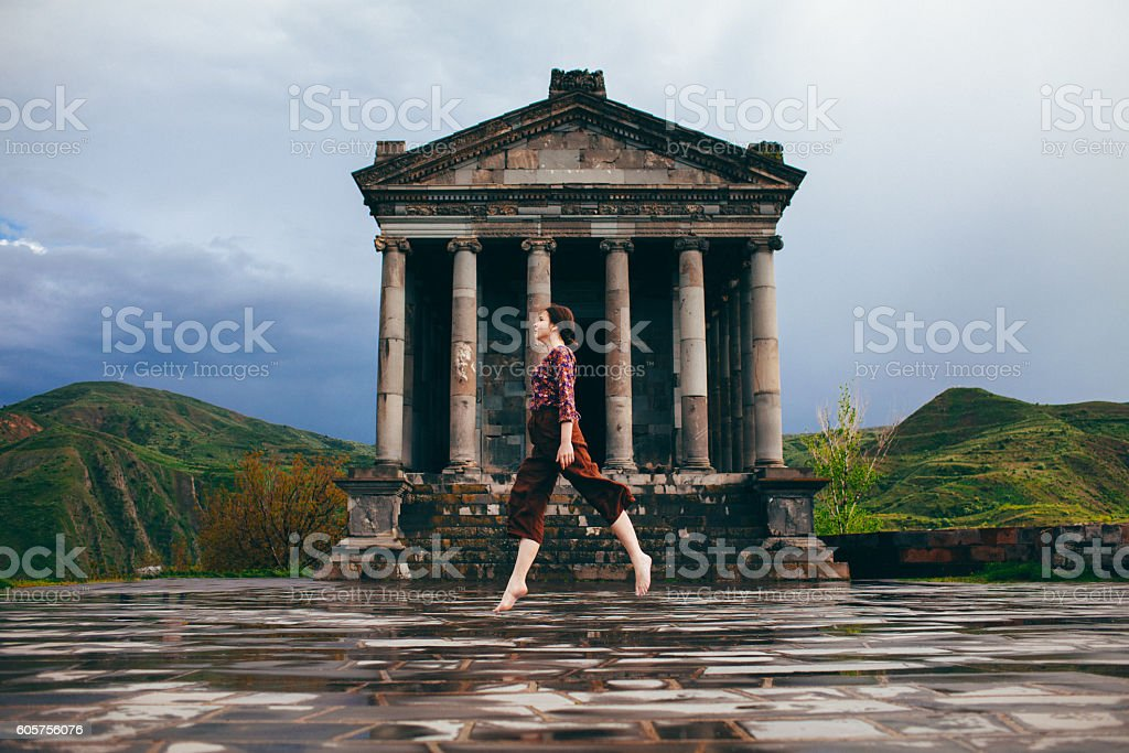 Girl near the Ancient Temple stock photo