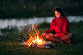 Girl near the campfire