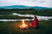 Girl near the campfire