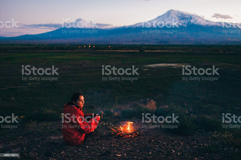 Girl near the fireplace stock photo
