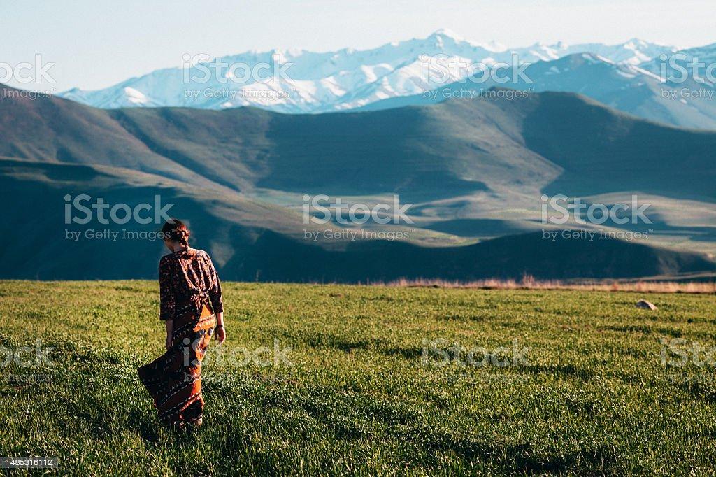 Girl near the mountains stock photo