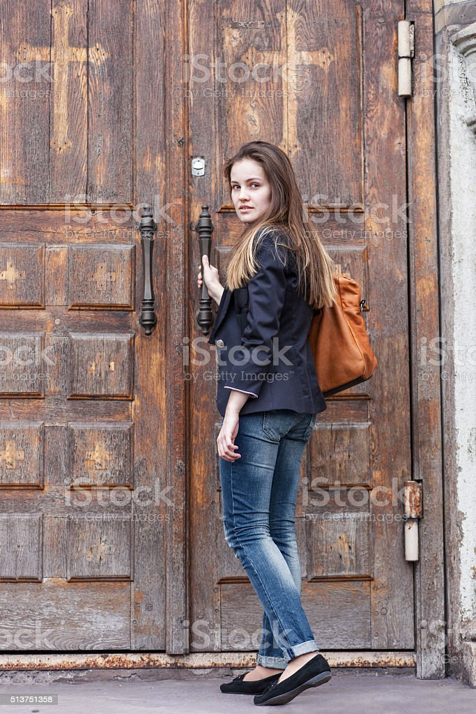 Girl near the old door stock photo