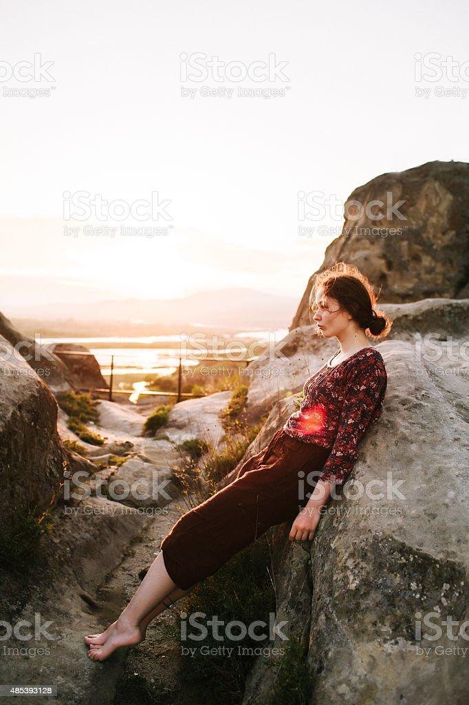 Girl near the rocks stock photo
