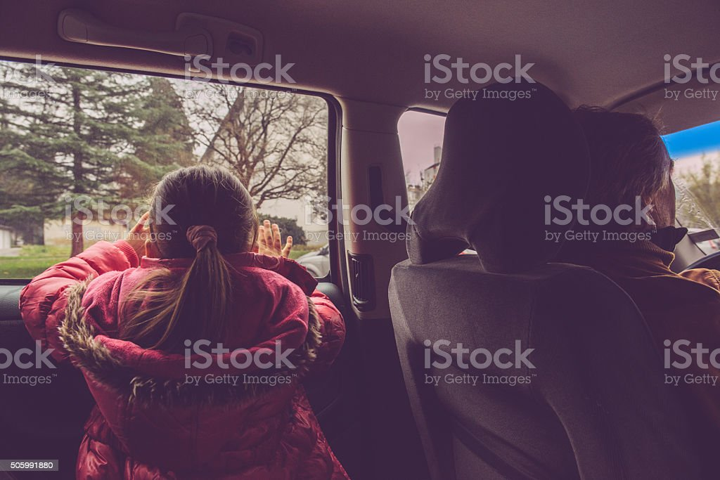 Girl of Five in Pink as a Back Seat Traveler stock photo