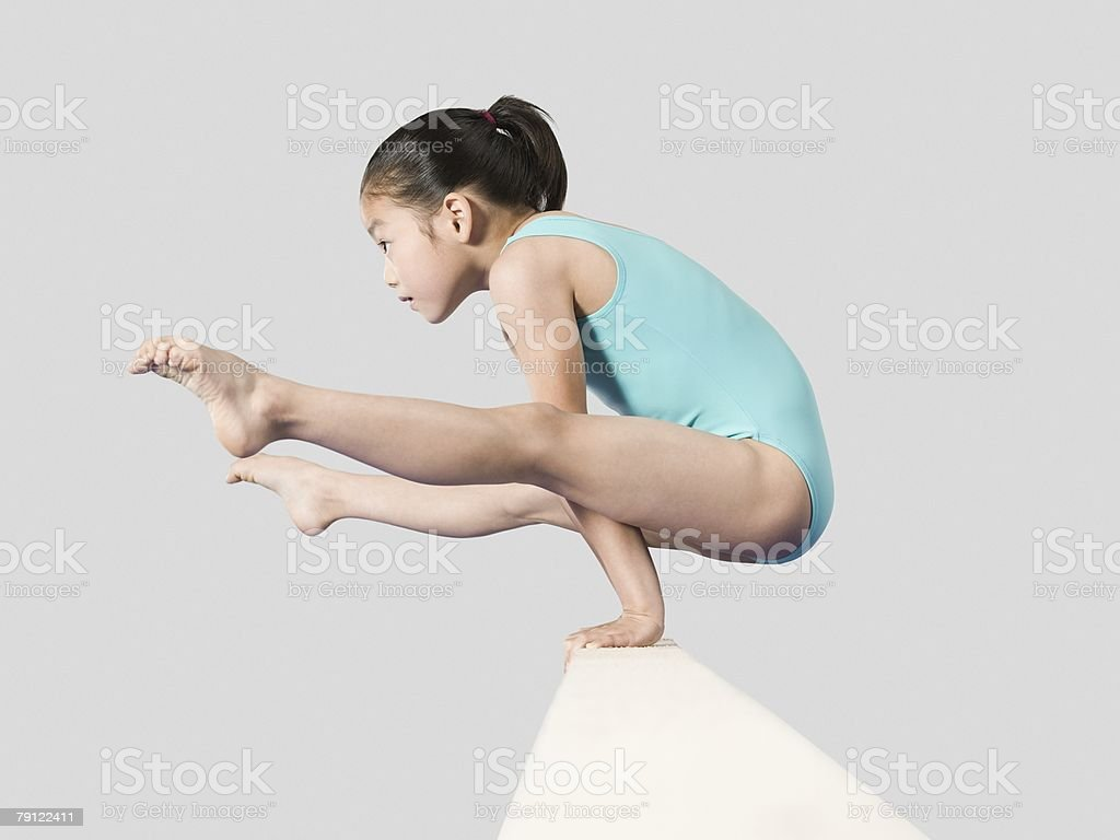 Girl on a balance beam stock photo