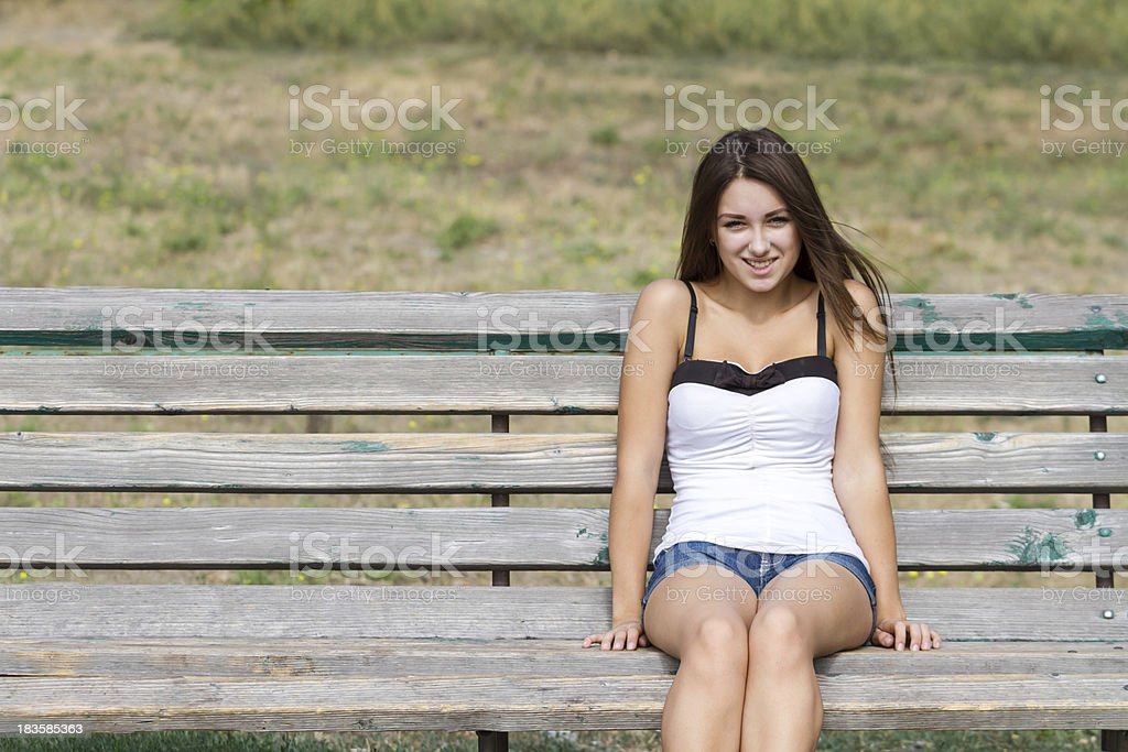 Girl on a bench with copy space royalty-free stock photo