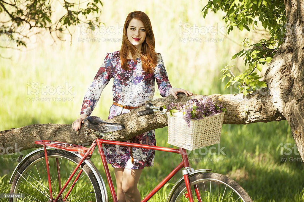 Girl on a bike in the countryside stock photo