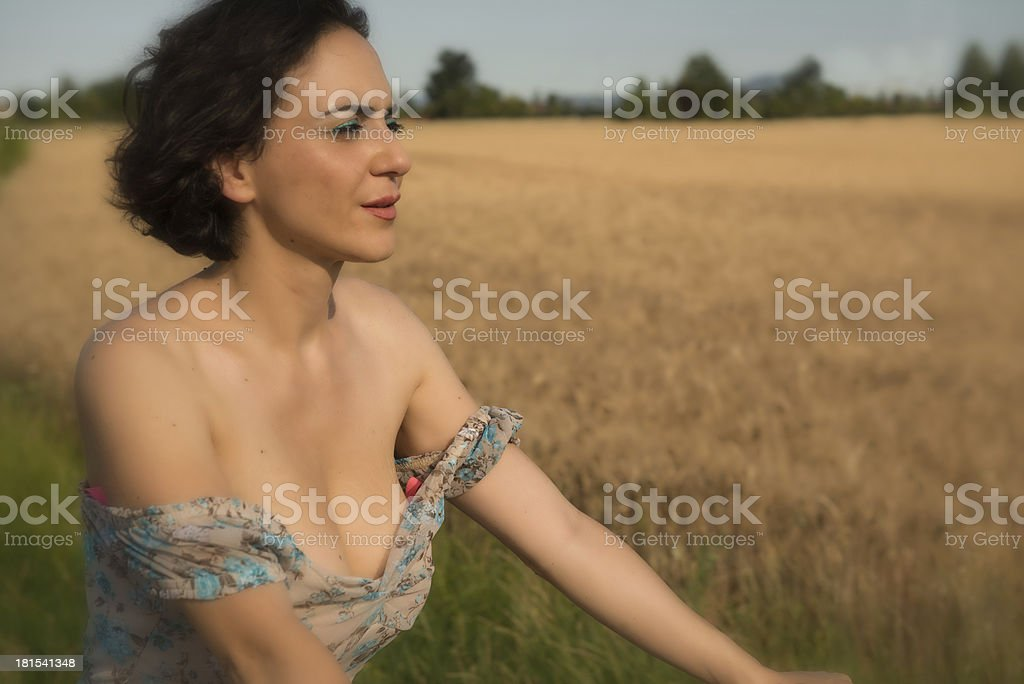 Girl on a bike in the countryside royalty-free stock photo