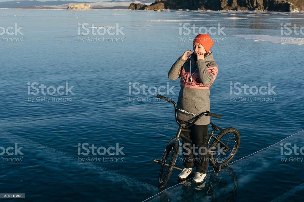 Girl on a bmx on ice. stock photo