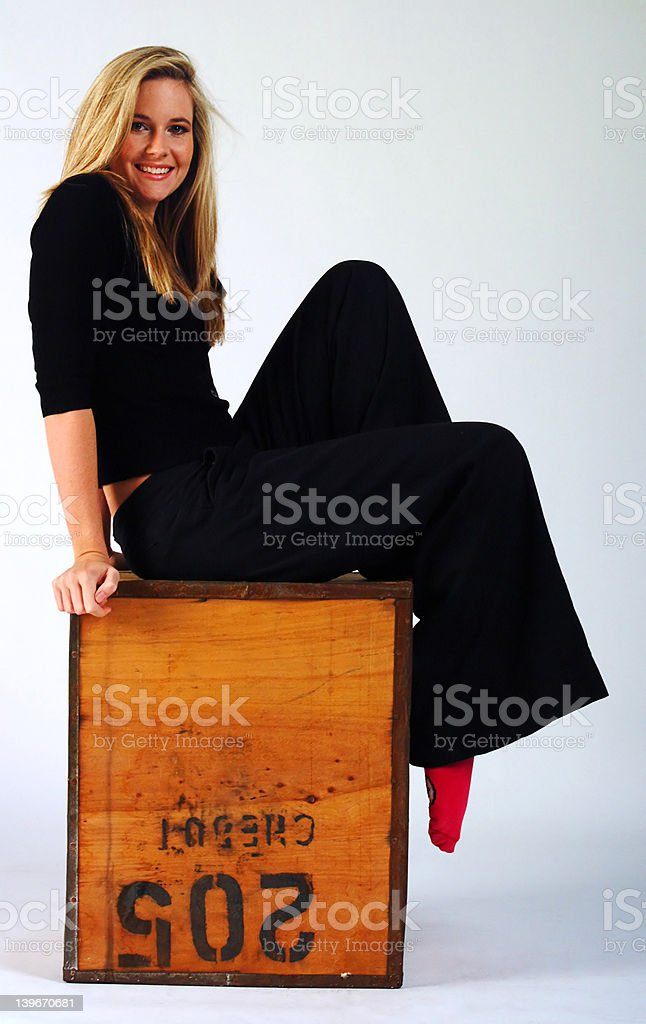 Girl on a box royalty-free stock photo