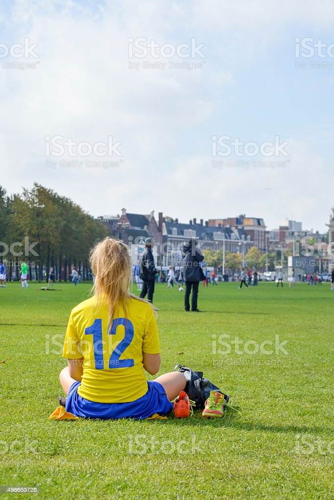 Girl on a break from a soccer game stock photo