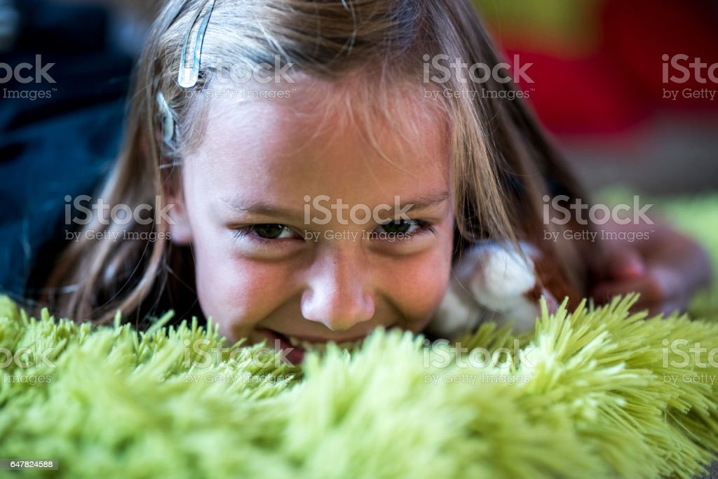 Girl on a green fluffy blanket stock photo