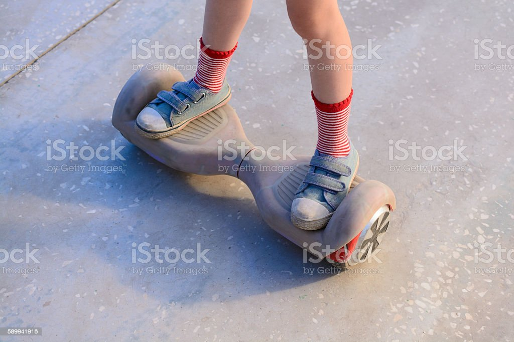 Girl on a hoverboard stock photo