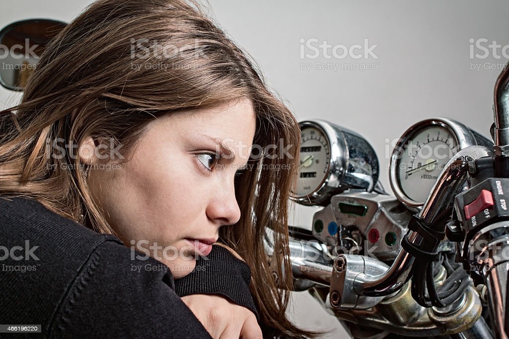 Girl on a motorcycle stock photo