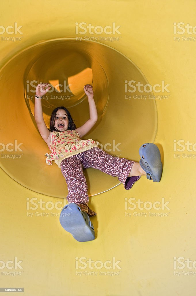 girl on a playground slide royalty-free stock photo