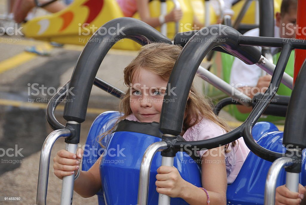 Girl on a ride at the fair stock photo