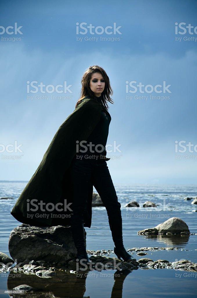girl on a rocky shore stock photo