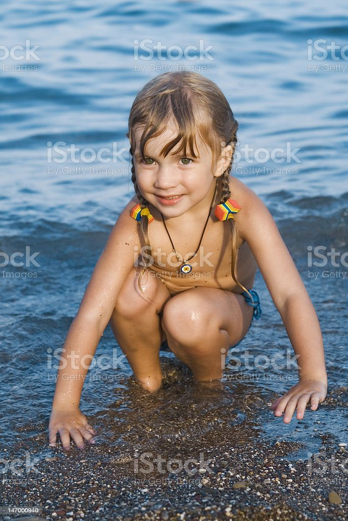 Girl on a seashore royalty-free stock photo