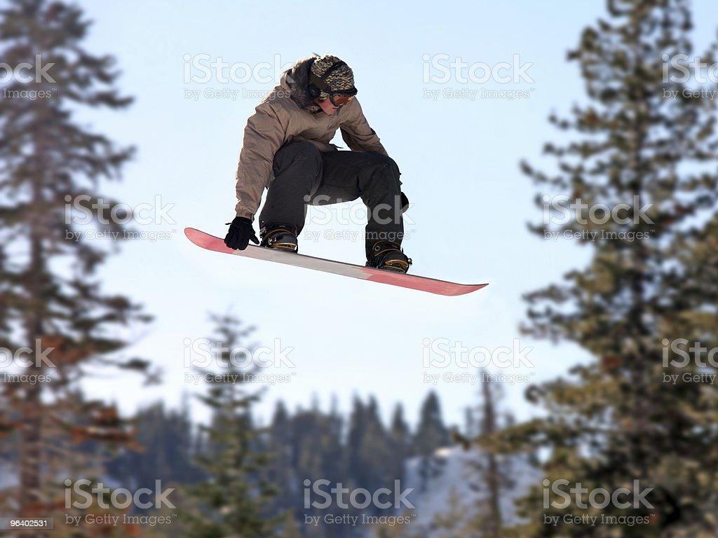 Girl on a snowboard royalty-free stock photo