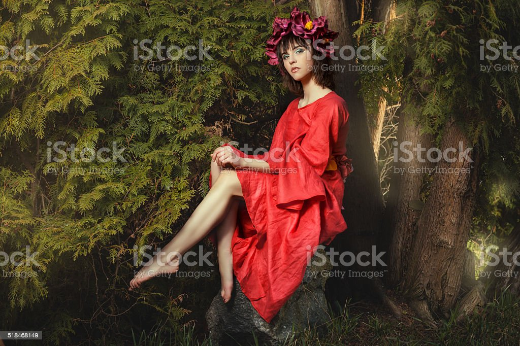 Girl on a stone. stock photo