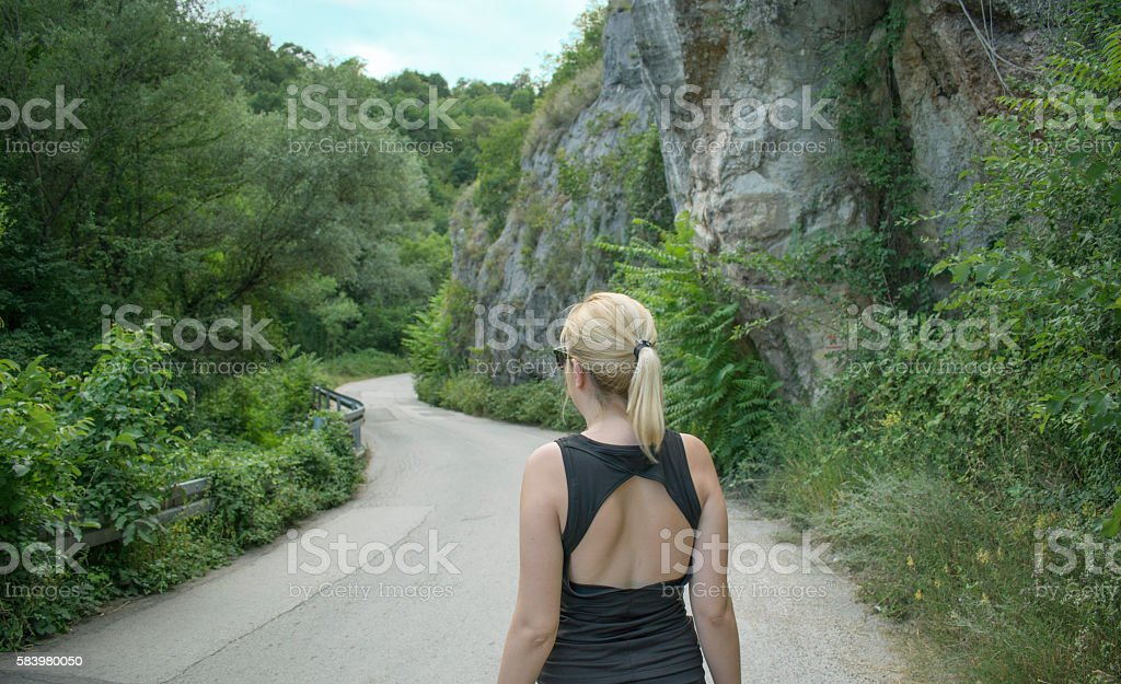 Girl on an empty road stock photo