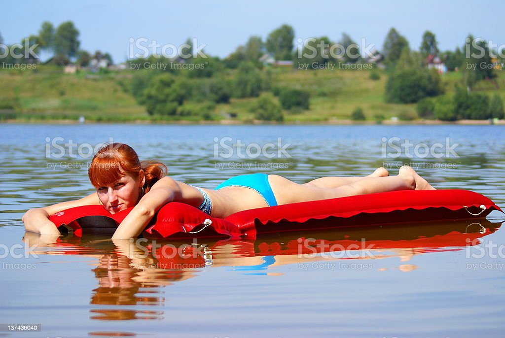 girl on an inflatable mattress royalty-free stock photo