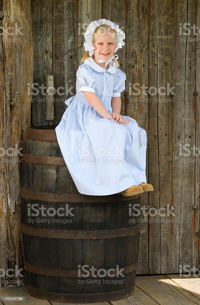Girl on Barrel stock photo