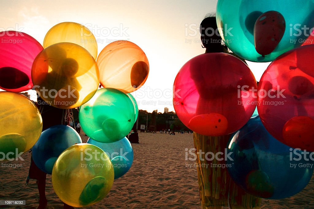 Girl on Beach with Colorful Balloons royalty-free stock photo