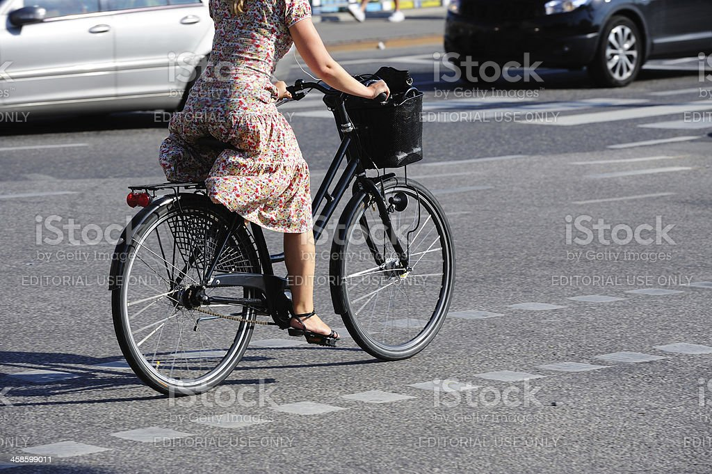 Girl on bicycle in traffic royalty-free stock photo