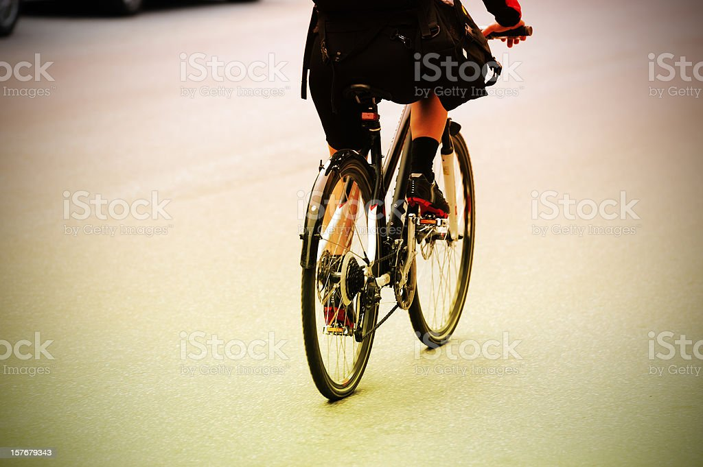 Girl on bike in the city royalty-free stock photo