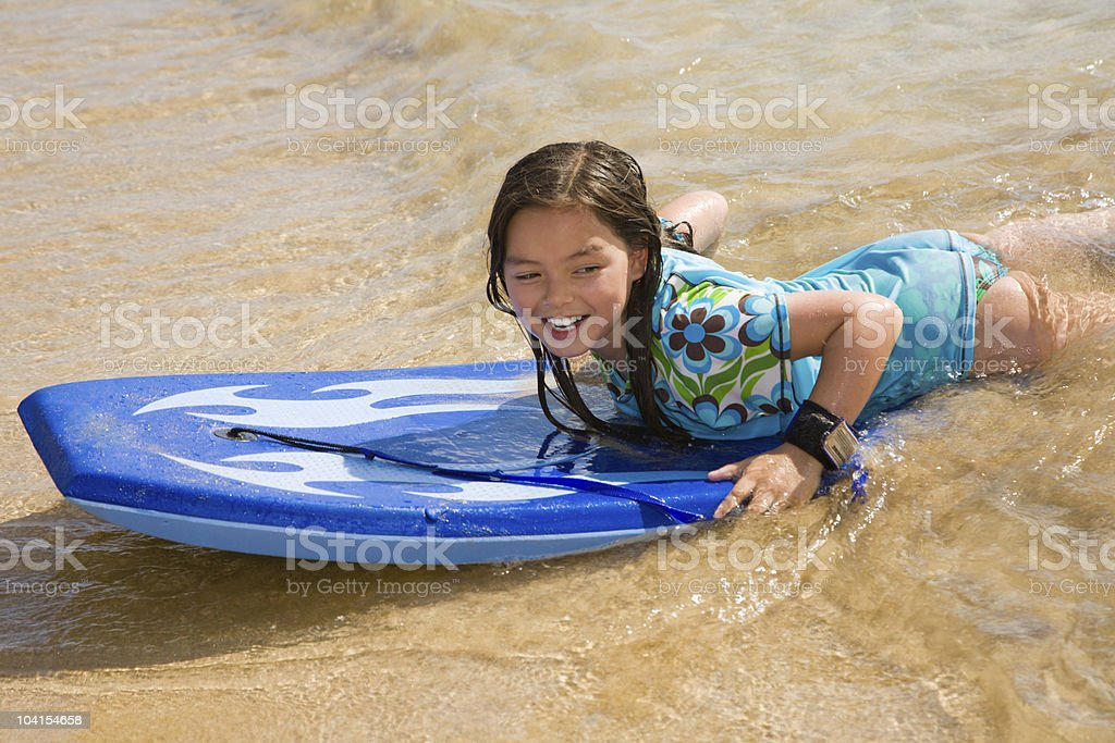 Girl on boogie board stock photo